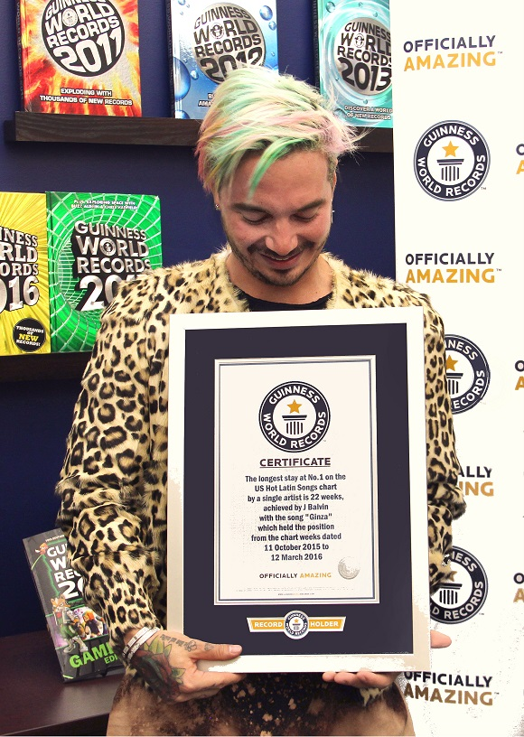 J Balvin holding his certificate