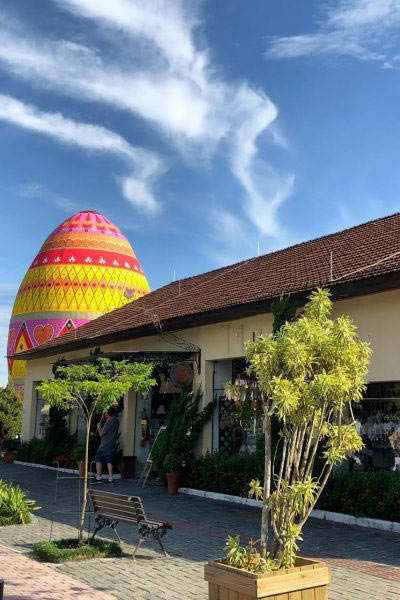 Largest decorated Easter Egg behind bungalow
